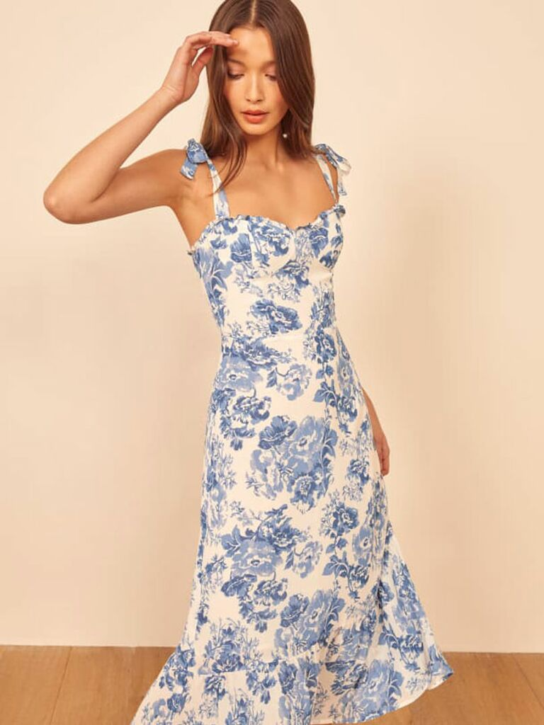 Blue and white floral midi dress with tie sleeves and ruffled hemline