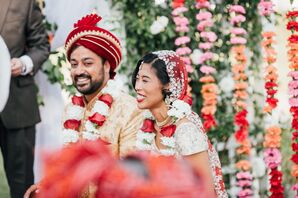 Couple Under Mandap at Colorful Interfaith Ceremony