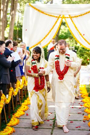 Couple Recesses Down Aisle Lined with Marigold Garlands