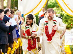 Sheila Kumar (34 and a doctor) and Russ Davis (34 and a lawyer) decorated with sunny florals and served up an East-meets-West meal that honored both t