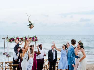 beach wedding bouquet toss