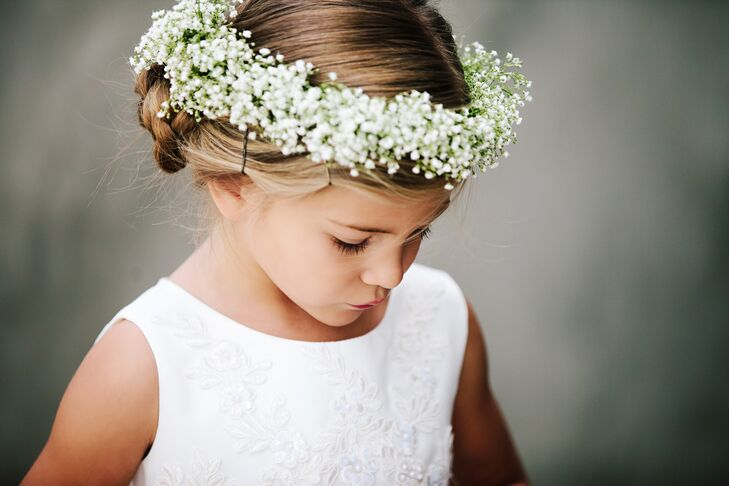 The flower girls wore baby's breath flower crowns tied with a white ribbon in the back, adding a romantic feel to the classic style of the wedding theme.