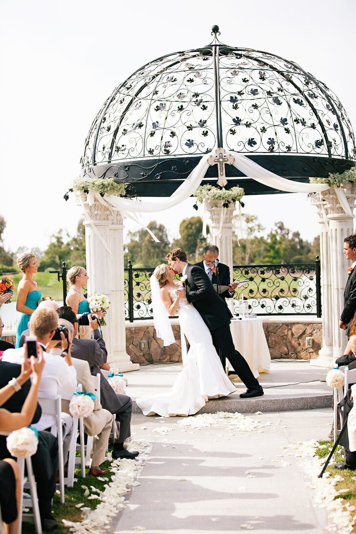 The couple exchanged vows outdoors, under a gorgeous column gazebo on Old Ranch Country Club's grounds.