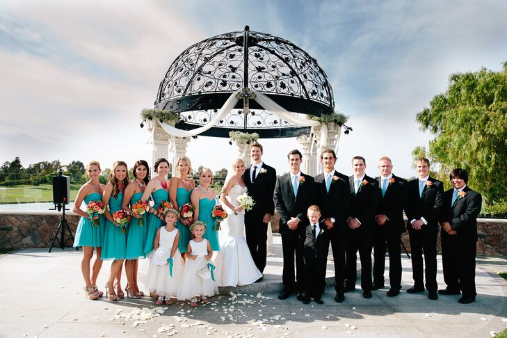 The bridesmaids wore teal strapless chiffon Donna Morgan dresses, while the groomsmen wore black suits with white button-ups and teal ties.