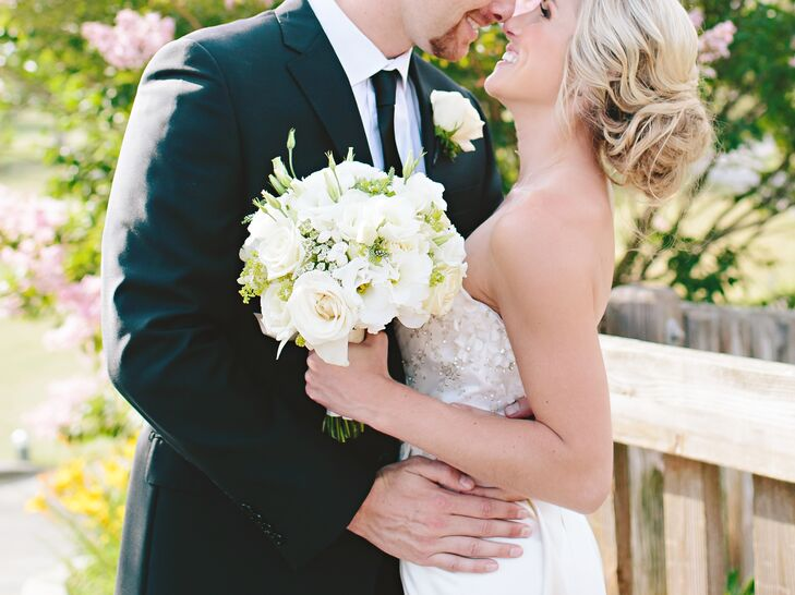 Karlie carried an all-white bouquet of roses and lisianthus, designed and arranged by Couture Flowers.
