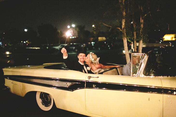 Guests sent off the couple with a sparkler exit, and the couple left their wedding in style in a vintage white Oldsmobile.