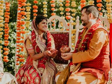 Indian bride and groom during wedding ceremony with yellow and orange fall wedding color scheme