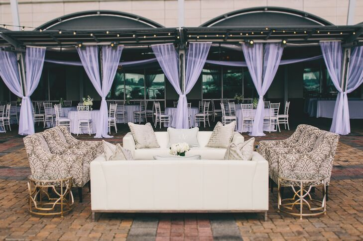 Wanting to add a lounge area for guests to smoke cigars (from the cigar bar they provided), they had an outdoor seating area that matched the wedding colors. The sofas were topped with monogrammed pillows for a little added personalization.
