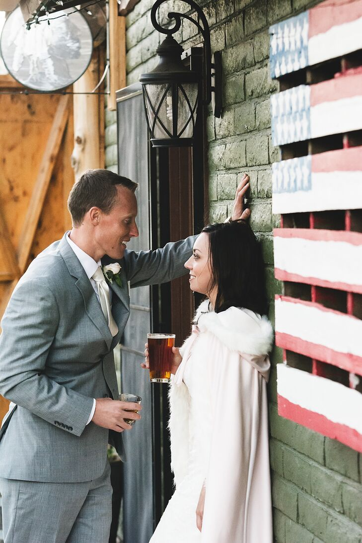 Sarah and Kolton leaned against the wood wall of their reception venue, the Nickel Beer Company in Justin, California.