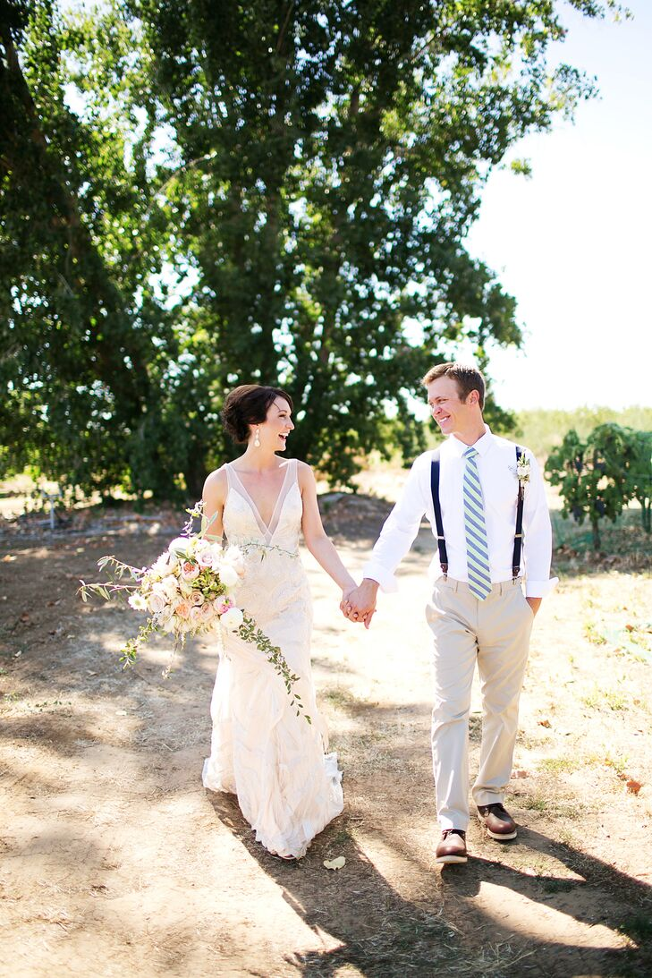 Bonny had her hair styled into an elegant updo that reveled her dangling crystal earrings, which was the only jewelry she wore on the wedding day. She held Doug's hand as they walked through Gale Vineyards in Durham, California.