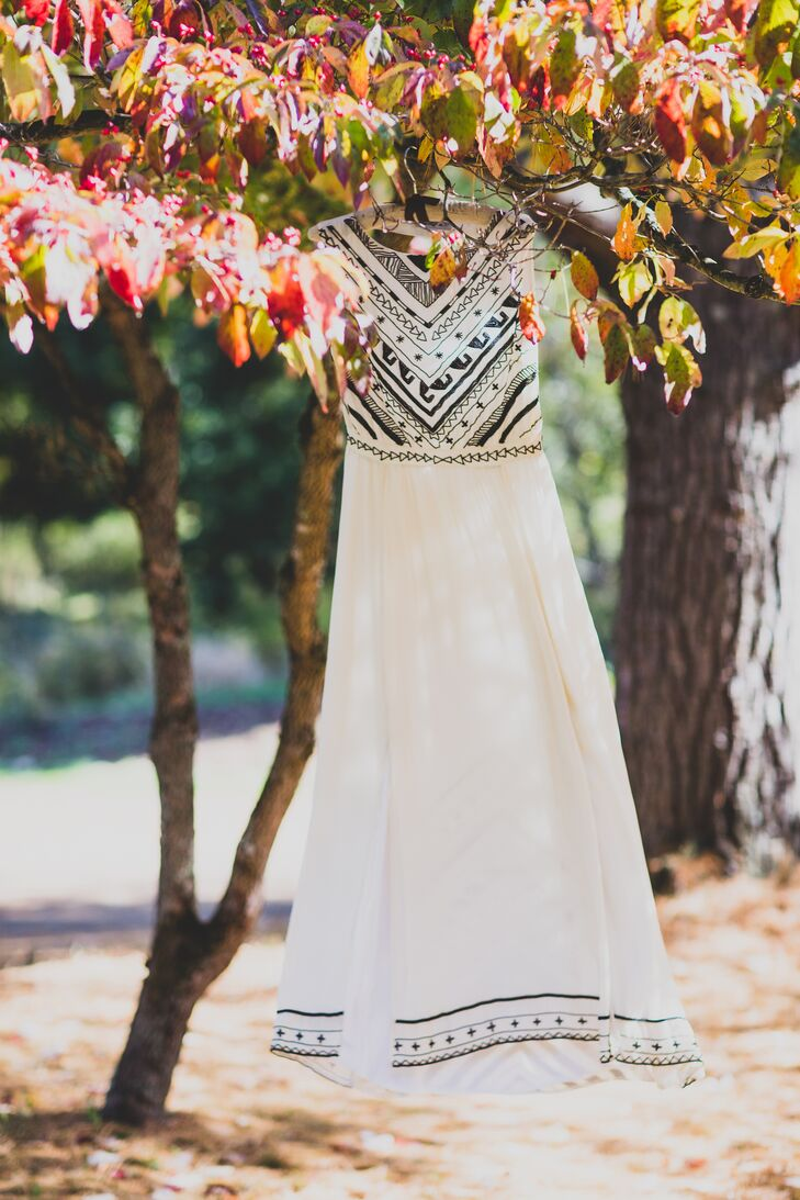 Amy found her ivory wedding dress designed by Mara Hoffman at Free people, with detailed black beading geometric patterns on the top with a long ivory skirt.