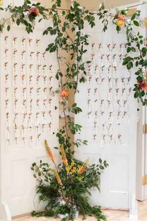 Paper Escort Card Display on White Doors and Greenery