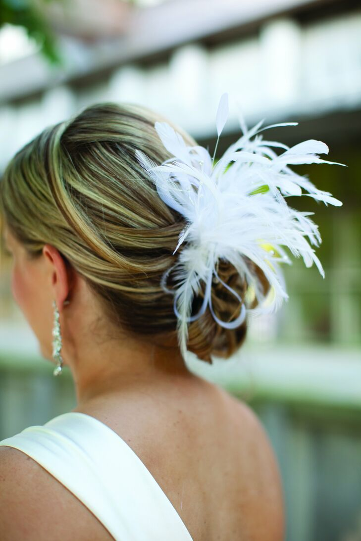 After the ceremony, Amy removed her veil and kept her feather hairpiece tucked into her low updo.