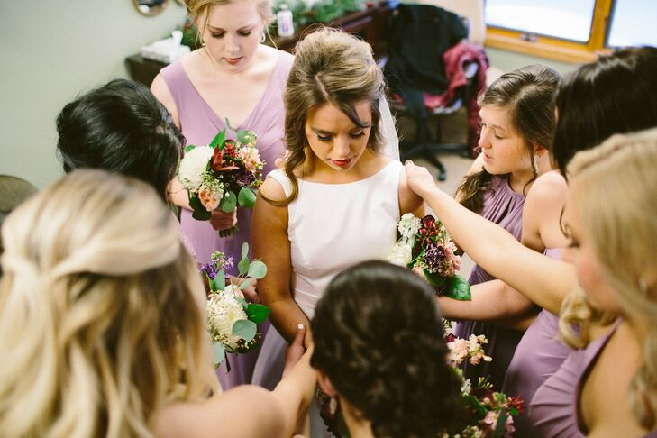 Kelli and her bridesmaids said a prayer before the ceremony at Charity Lutheran Church began.