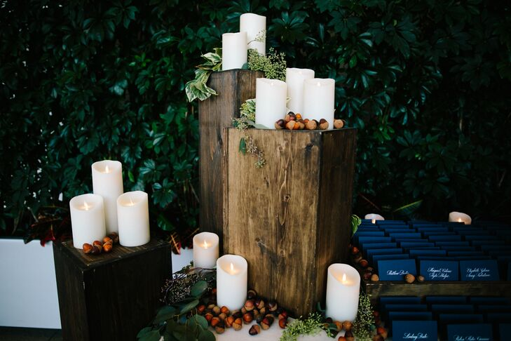 White Candles on Tree Stumps with Acorns