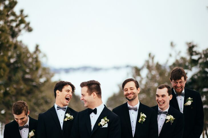 James wore a very classic black-and-white tuxedo, complete with a black bow tie and white boutonniere. The groomsmen wore similar Vera Wang tuxedos with gray bow ties to match the bridesmaid dresses. Also, having slightly different bow ties helped them to look similar enough to the groom to match the formality of the wedding, but different enough for a little personalization.