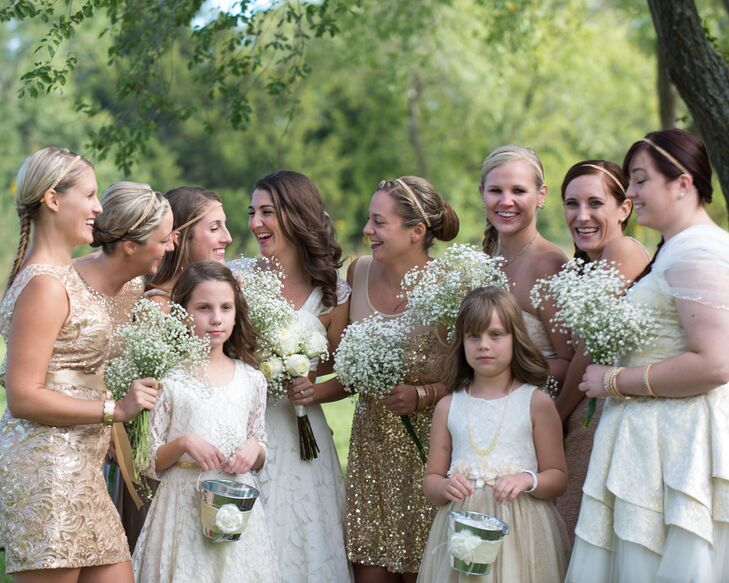 """The bridesmaids wore gold dresses. """"I embrace individuality, and my lovely ladies were all able to pick a dress of their choice that shined as bright as they were comfortable wearing,"""" Larrissa says."""