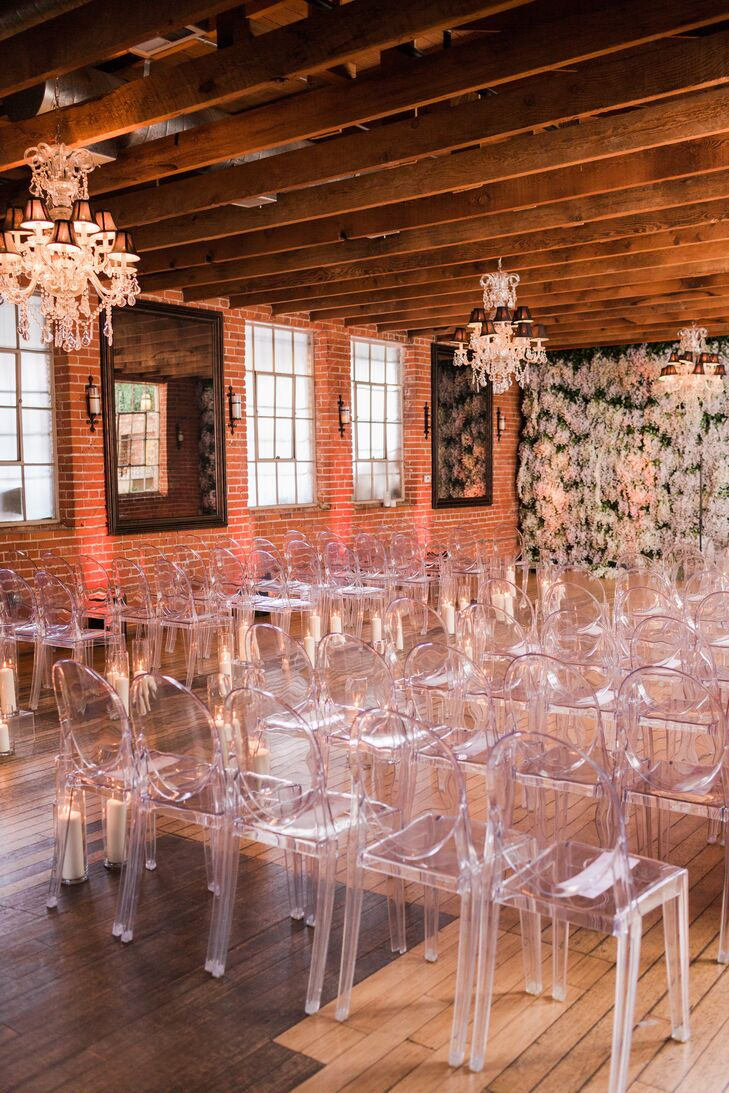 Ceremony with Ghost Chairs and a Flower Wall