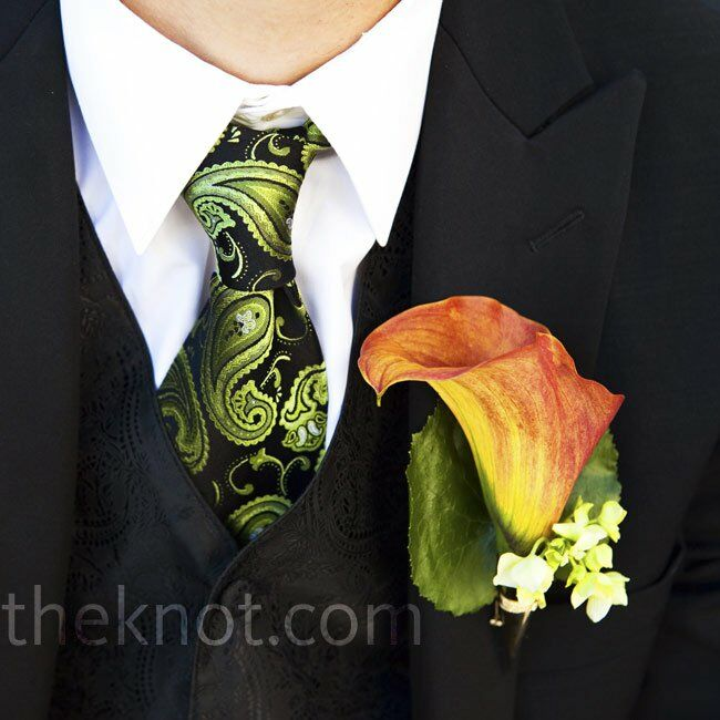 A rich orange calla lily with tiny white blooms complemented the groomsmen's green paisley ties.
