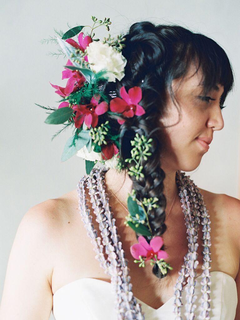 wedding braid hairstyles bold side braid with flowers
