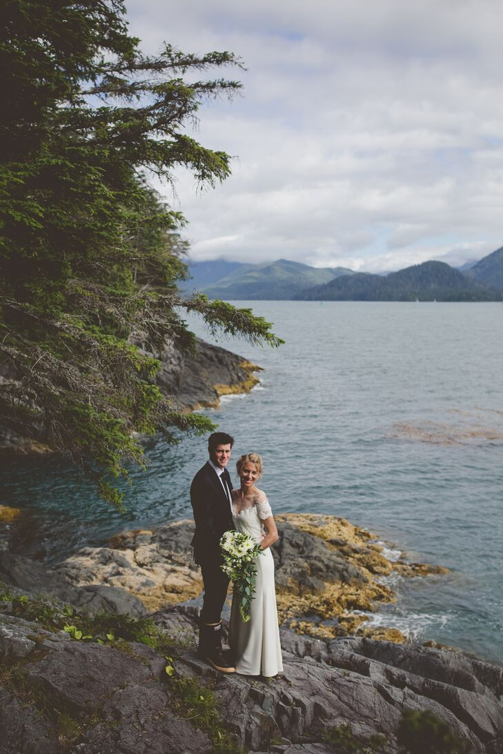 """""""Our ceremony was on my parents' property on Whale Island in Sitka Sound,"""" Megan says. """"We picked out a spot in a small cove near their house. It's so special because that spot will always be in our family."""""""