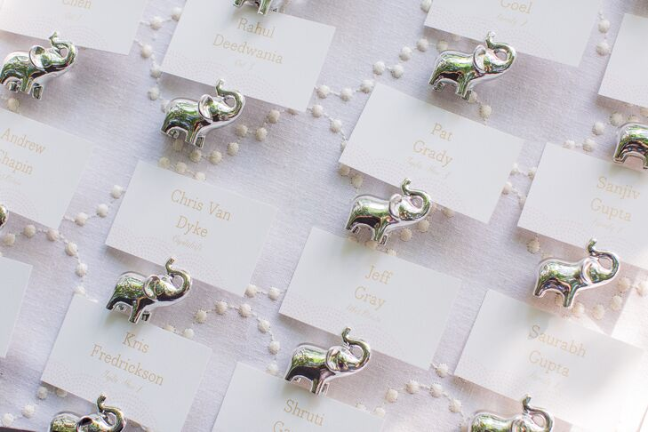 In a reference to Gautam's Indian heritage, escort cards were  anchored with petite silver elephants.