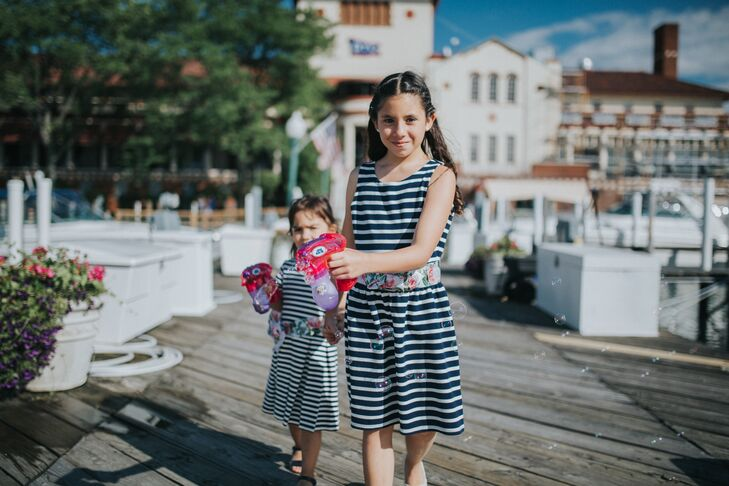 "The flower girls wore navy-and-white-striped dresses and walked down the dock (aisle) to Elvis Presley's ""Can't Help Falling in Love."""
