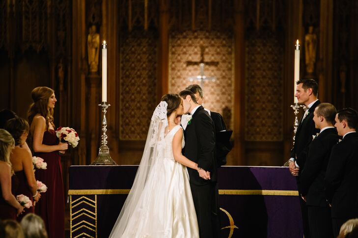 Kara wore a vintage wedding dress from her grandmother and a cathedral-length veil from her mother. She loved the lace-adorned tulle and the sentimental value it provided.