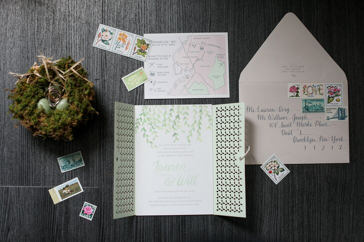"To ensure their stationery maintained a cohesive feel, Lauren and Will worked solely with Shindig Invites to create everything from the invitations to the escort cards and menus. The spring season served as the inspiration for the invitations, with Shindig creating an elaborate trifold design with watercolor vines, whimsical hand-lettering and folds that mirrored the iconic lattice gates commonly found in gardens. ""We had a lot of fun with the other pieces in our invitation suite,"" Lauren says. ""The weekend activities card featured cute icons and had more watercolor elements in pink and green, including a map of Brooklyn that identified where each of the weekend's activities were."""